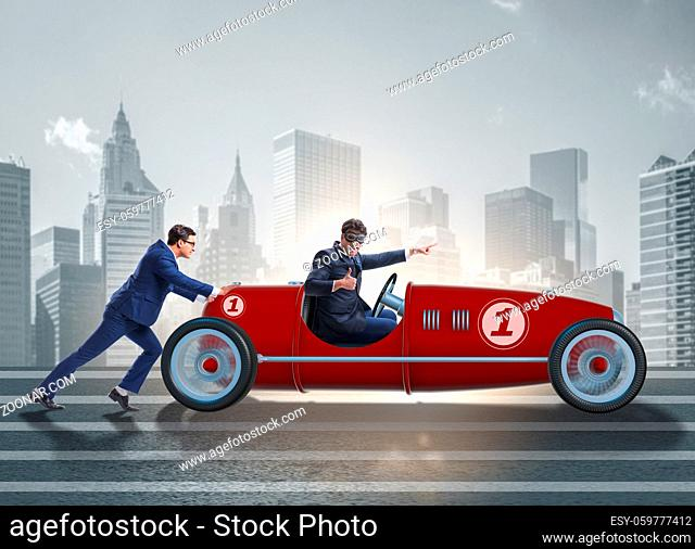 The businessman car pushing in teamwork concept