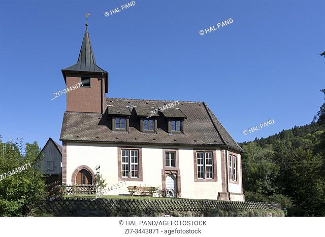 little sankt Georg church at touristic historical village, shot in bright summer light at Betzweiler, Baden Wuttenberg, Germany