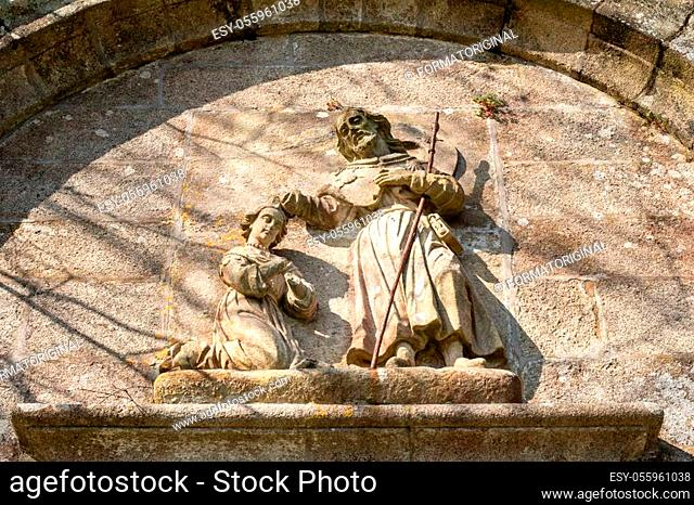 Saint James the apostle baptizing Lupa Queen scene stone bas-relief on St. James church, Padron Spain