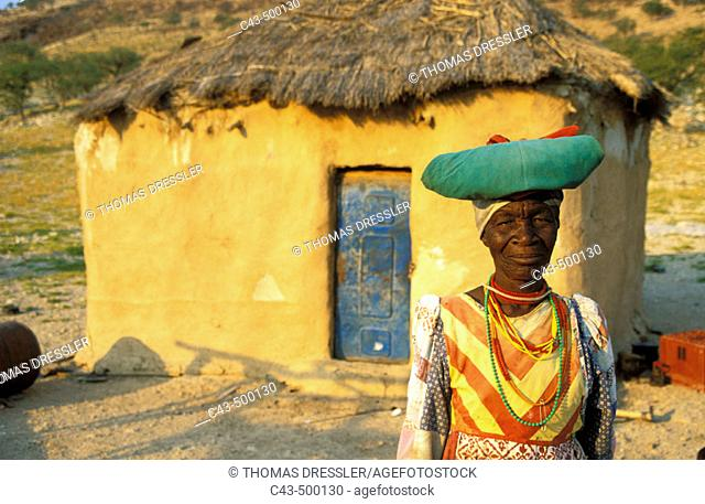 Traditionally dressed Herero woman at her house in the vicinity of Warmquelle, a village in the southern Kaokoveld. Namibia