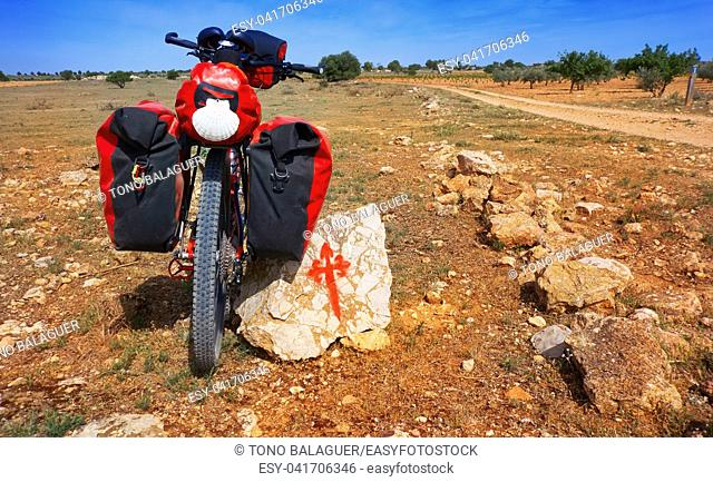 Saint James Way pilgrim bike and Templarios cross sign by Camino de Santiago of spain