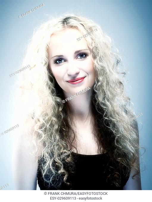 Portrait of a Young Woman with Curly Blond Hair