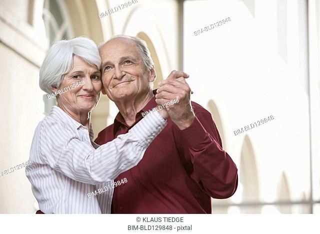 Senior Caucasian couple dancing