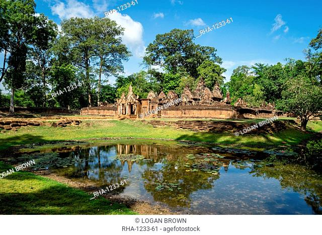 A deserted temple reflected in a lake in Siem Reap, Cambodia, Indochina, Southeast Asia, Asia