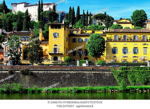 historic buildings and gardens along Arno river, Lungarno Torrigiani, Chiesa Evangelica Luterana - Evangelical Lutheran Church behind tree