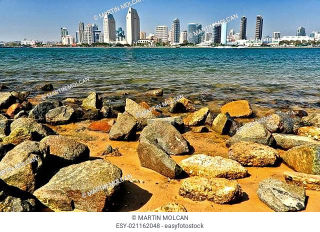 San Diego city view with rocks and water foreground