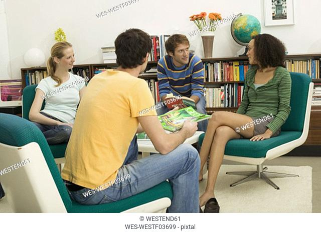 Four young people sitting in circle