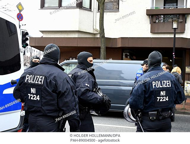 German police officials and vehicles stand outside the German-speaking Islamic Society of Hildesheim (DIK) mosque in Hildersheim, Germany, 14 March 2017