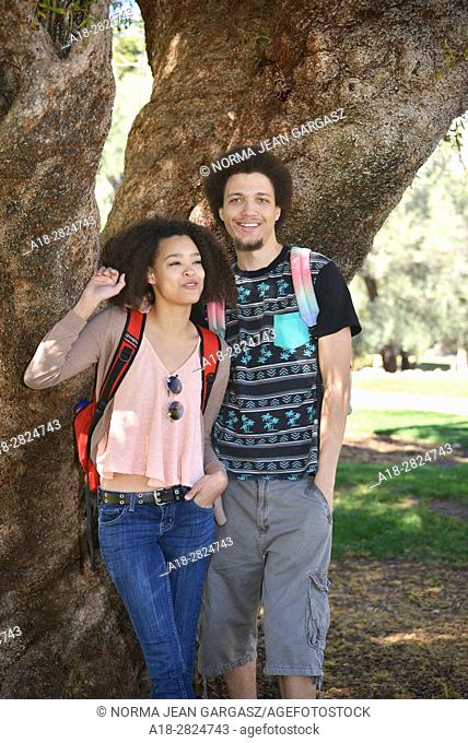 A young woman and man on a college campus