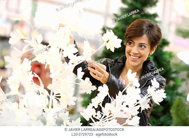 woman buying Christmas tree, garden center