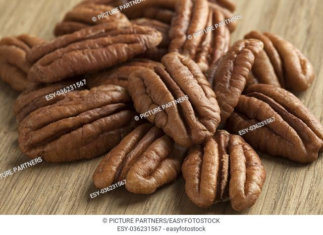 Heap of peeled pecan nuts close up