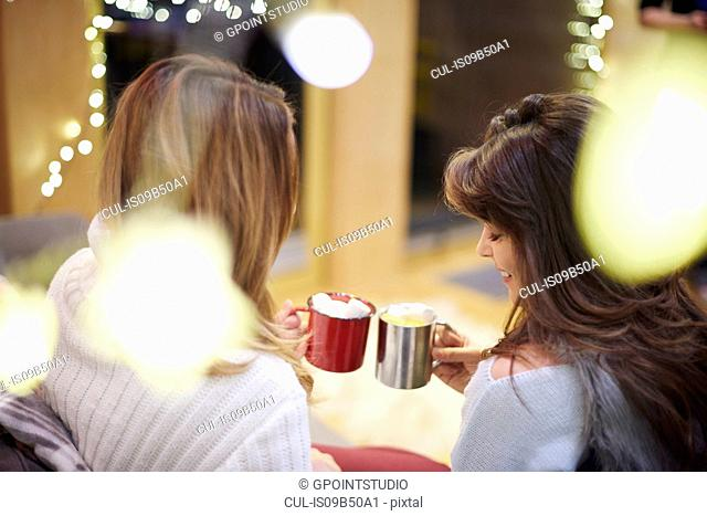 Friends toasting with hot chocolate drink