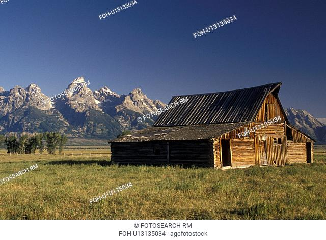 Jackson Hole, WY, Grand Teton National Park, Wyoming, Old wooden barn at Antelope Flats with a view of the Grand Teton Mountains in the background in Grand...