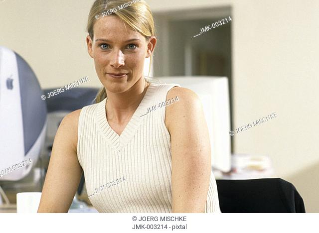A young woman, businesswoman, 25-30 30-35 35-40 years old, sitting in an office