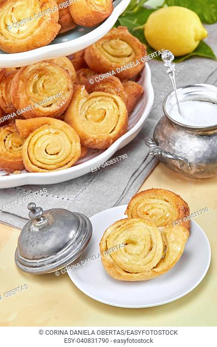 Closeup of Italian pinwheel orange pastries, typical sweets made during the carnival period