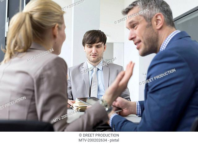 Couple quarrel in front of colleague