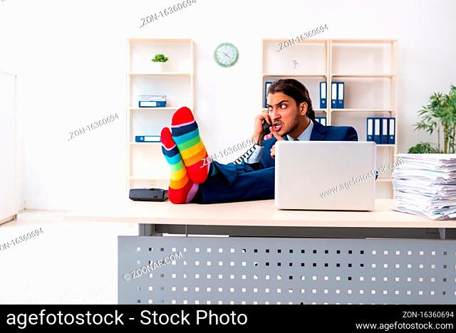 The young male businessman working in the office