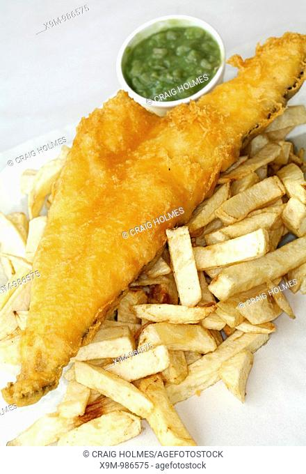 Fish cod and chips and mushy peas from a chip shop