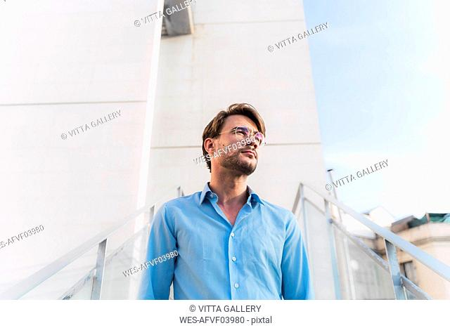 Portrait of casual businessman looking away