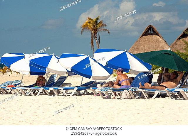 Scene from the beach with sunbathing tourists, umbrellas and sunbeds, Isla Mujeres, Cancun, Quintana Roo, Yucatan Province, Mexico, Central America