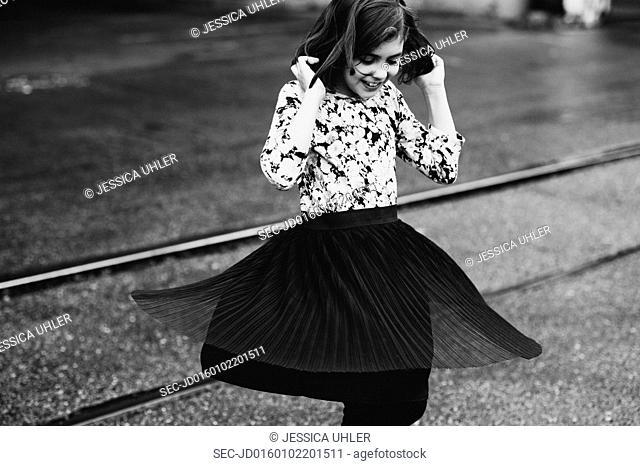 Young girl dancing on street