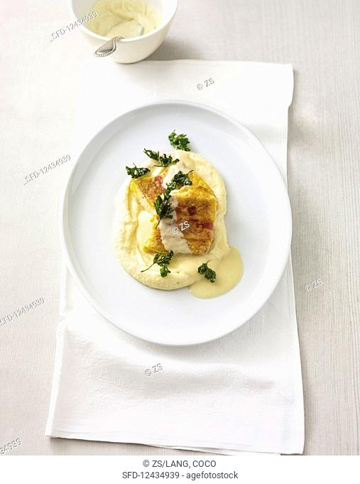 Pike wrapped in bacon on root vegetable puree