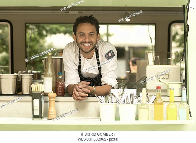 Portrait of smiling man in a food truck
