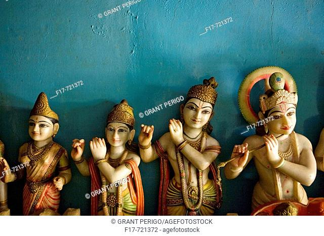 a still life of statues of flute players in india