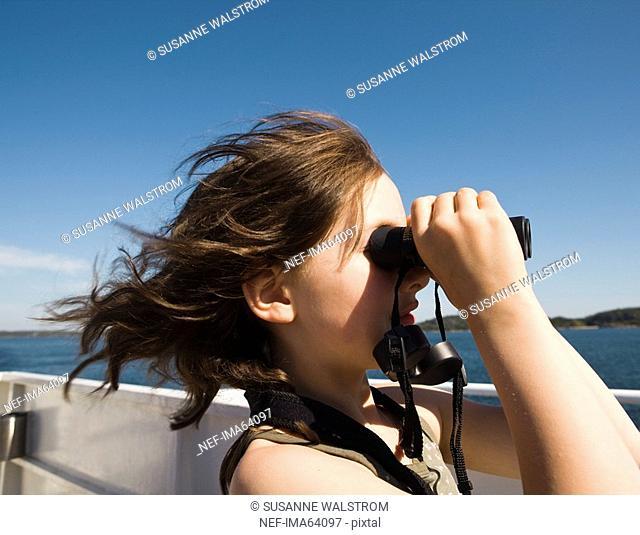A girl with a binoculars, Sweden
