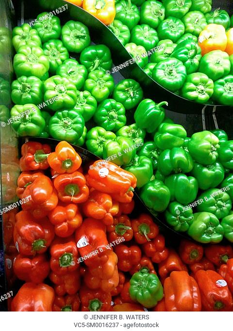 Bell peppers of different colors at the market. Capsicum Annuum