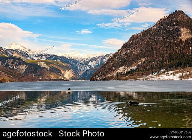 Clear Cold Landscape with blue sky at Grundlsee, Austria, winter, frozen lake. Tourist destination
