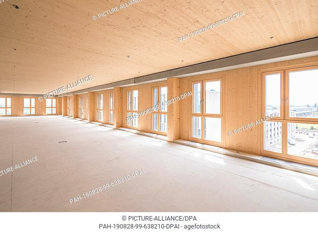 """27 August 2019, Austria, Wien: A room inside the new """"""""Hoho Wien"""""""", a high-rise consisting of 75 percent wooden parts from the first floor upwards and located..."""