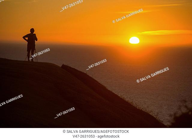 Photographer photographing the sunset on Mount San Pedro, La Coruna, Galicia, Spain, Europe