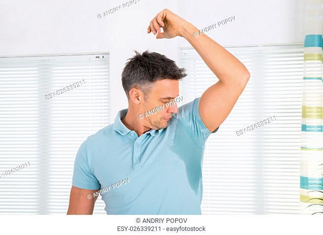 Mature Man Notices His Sweat Under Armpit