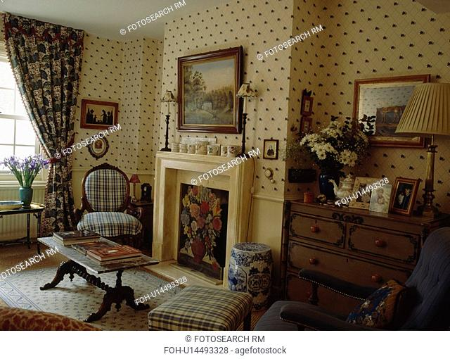 Spotted neutral wallpaper in townhouse livingroom with picture above cream fireplace with floral firescreen&13,&10,&13,&10