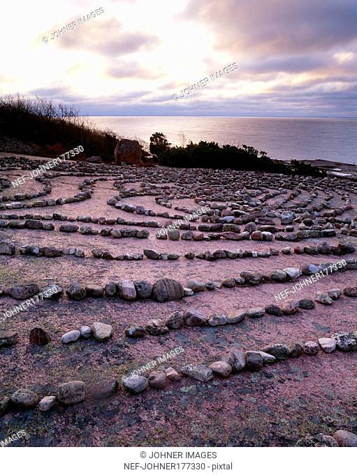 Stones arranged on ground near sea