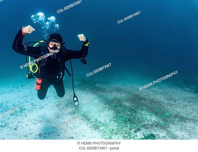 Strong pose of female scuba diver close to Komodo Island, portrait, Nusa Tenggara Timur, Indonesia