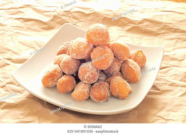 castagnole, typical Italian fritters carnival period. with flour, sugar, eggs, butter or oil, vanilla, baking powder, liquor and sprinkled with granulated sugar