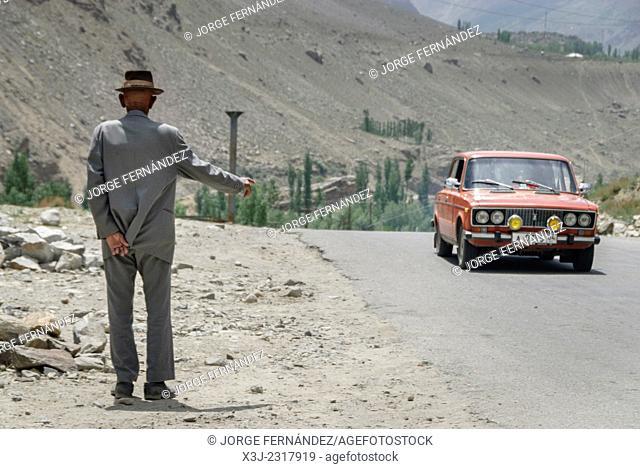 Old man hitchhiking near Khorog, Pamir Highway, Tajikistan