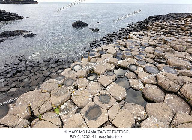 The Giant's Causeway is an area of about 40, 000 interlocking basalt columns, the result of an ancient volcanic eruption