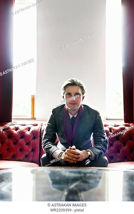 Portrait of businessman sitting on sofa
