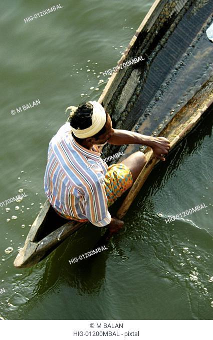 MAN ON COUNTRY BOAT IN AKKULAM