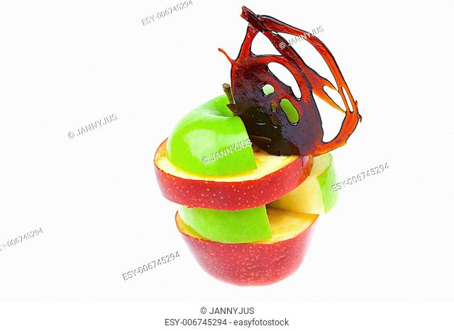 slit apple slices and caramel isolated on white