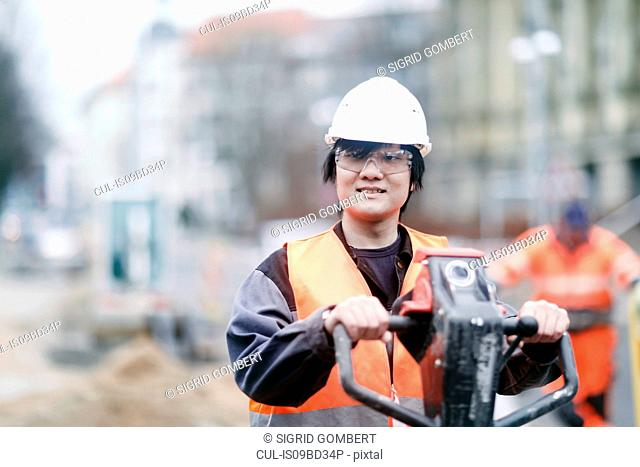Young construction worker wearing hard hat