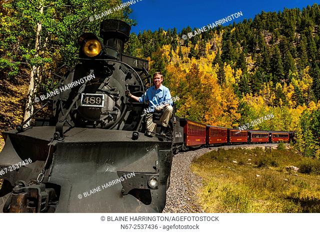 Governor John Hickenlooper (of Colorado) on a visit aboard the the Cumbres & Toltec Scenic Railroad, from Antonito to Osier, Colorado during peak autumn color