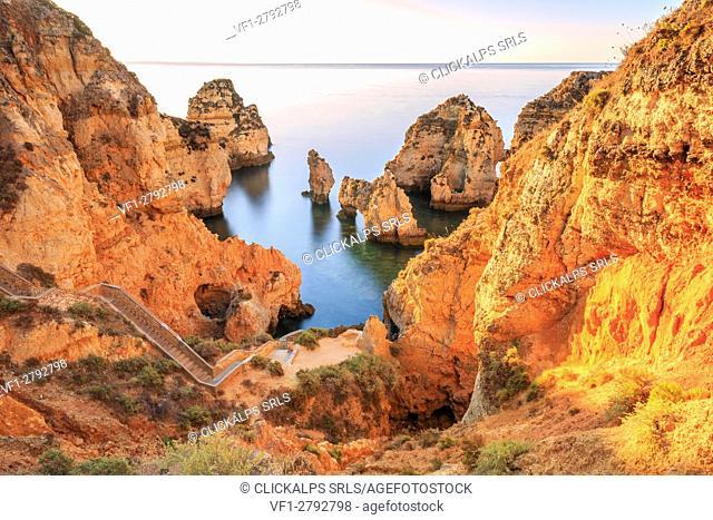 Golden sunrise on the red cliffs of Ponta da Piedade Lagos Algarve Portugal Europe