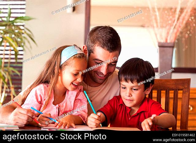Father helping his children for homework