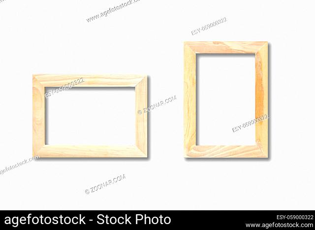 Two wooden picture frames hanging on a white wall. Blank mockup template