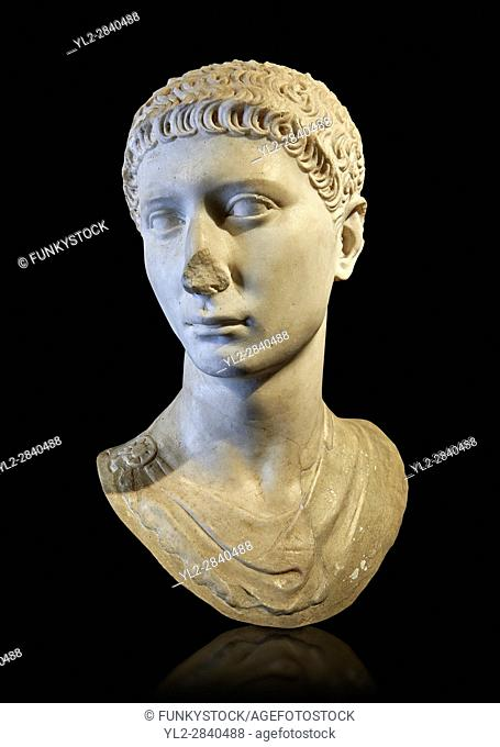 Roman portrait bust of a young charioteer from the age of Domitian, 81-96AD. This statue of a young charioteer, with Oriental eastern Mediterranean features