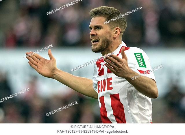 Cologne's Simon Terodde gestures during the German Bundesliga football match between 1. FC Cologne and FC Augsburg at the RheinEnergieStadion in Cologne